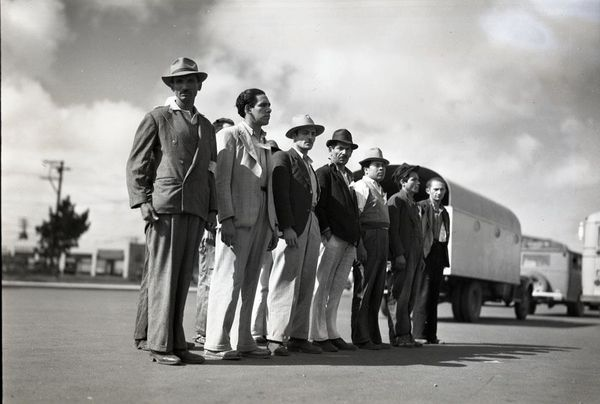 -Ten-Mexican-workers-standing-near-trucks.--1942.jpg