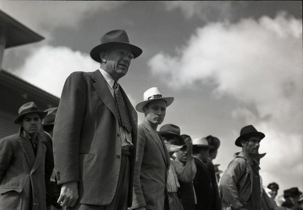 Government-Official-with-Mexican-workers.-1942.jpg