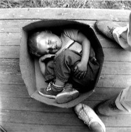 feccia-Child-asleep-in-a-box--Hooverville--1933.JPG