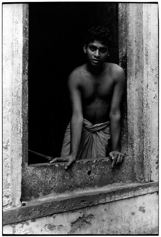 Man wearing dhoti looking out of window 1970 Benares Inde