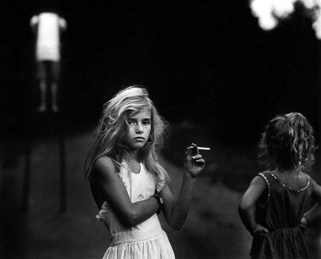 candy cigarette by sally mann One of the most famous photographs in the 20 th century is candy cigarette by sally mann she featured a preteen young girl in the photographs holding a ci.