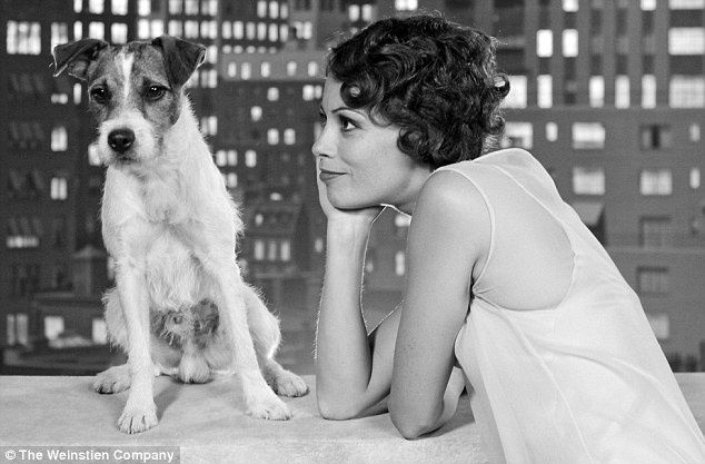 Golden-Globes-2012-Uggie-new-found-fame-The-Artist-sweeps-b.jpg
