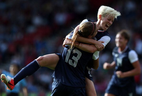Alex Morgan of USA is congratulated by Megan Rapinoe after