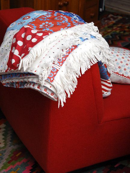 plaid en patchwork détail frange