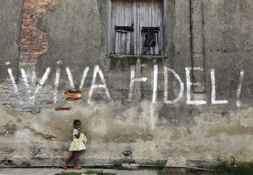 cuba-3-a-girl-stands-next-to-graffiti-that-reads-viva-fidel